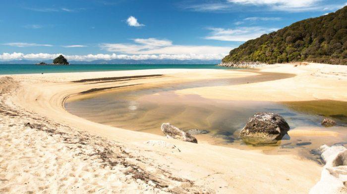 abel-tasman-water-sand-hero